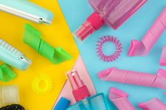 Hair cosmetics and hair accessories, hair curlers, combs, barrettes and elastic bands. on a bright multi-colored background. view stock photography