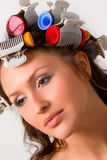 Hair-curlers. Nice girl with colorful hair-curlers stock photography