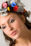 Hair-curlers. Nice girl with colorful hair-curlers stock photos