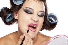 Hair curlers and bad make up Stock Photo