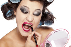 Hair curlers and bad make up Royalty Free Stock Photo