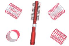 Hair curlers and hairbrush. Royalty Free Stock Images