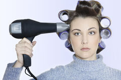 Hair-curlers victim Stock Image