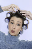 Hair-curlers victim Royalty Free Stock Photo