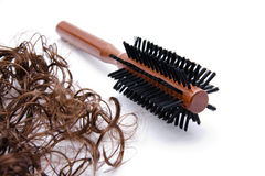 Hair curling brush and hair. On white background Stock Photography