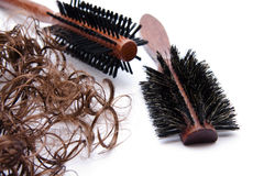 Hair curling brush and hair Stock Images