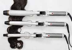 Hair curling iron with hair extension Stock Photography