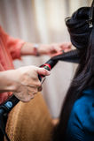 Hair curling Royalty Free Stock Photo