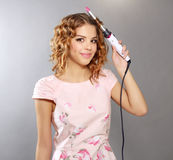 Hair curling. Young girl with curly hair Royalty Free Stock Photography