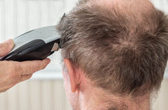 Hair cut. Closeup of a man getting a hair cut royalty free stock photography
