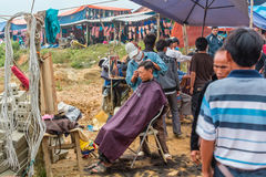 Hair cut in open-air barber shop Royalty Free Stock Photo