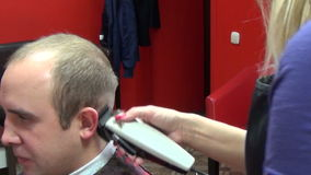 Woman has head shaved by barber apologise