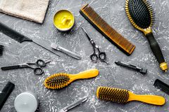 Hair cutting preparation with hairdresser tools on desk backgrou. Hair cutting preparation with hairdresser working tools on gray desk background top view stock photos