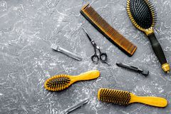 Hair cutting preparation with hairdresser tools on desk backgrou. Hair cutting preparation with hairdresser working tools on gray desk background top view mockup royalty free stock image