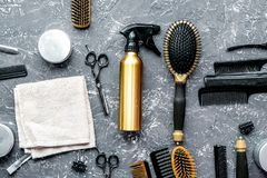 Hair cutting preparation with hairdresser tools on desk backgrou. Hair cutting preparation with hairdresser working tools on gray desk background top view stock photo