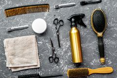 Hair cutting preparation with hairdresser tools on desk backgrou. Hair cutting preparation with hairdresser working tools on gray desk background top view stock images