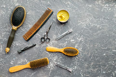 Hair cutting preparation with hairdresser tools on desk background top view mockup. Hair cutting preparation with hairdresser working tools on gray desk royalty free stock photos