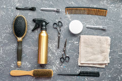 Hair cutting preparation with hairdresser tools on desk background top view. Hair cutting preparation with hairdresser working tools on gray desk background top royalty free stock image