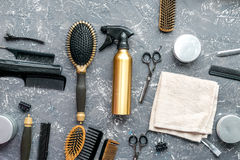Hair cutting preparation with hairdresser tools on desk background top view. Hair cutting preparation with hairdresser working tools on gray desk background top stock photo