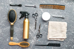 Hair cutting preparation with hairdresser tools on desk background top view. Hair cutting preparation with hairdresser working tools on gray desk background top royalty free stock images