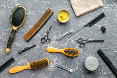 Hair cutting preparation with hairdresser tools on desk background top view. Hair cutting preparation with hairdresser working tools on gray desk background top royalty free stock photo