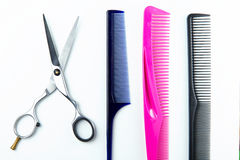 Hair cutting scissors and comb for hairdressers. Royalty Free Stock Image
