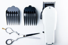 Hair cutting scissors and hair clippers for hairdressers. Stock Photo