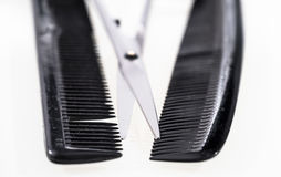 Hair cutting shears and comb isolated on white Royalty Free Stock Photo