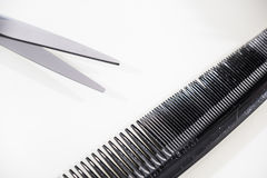 Hair cutting shears and comb isolated on white Stock Photos