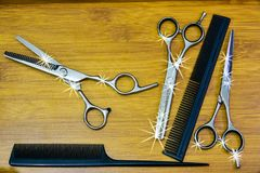 Hair cutting shears and comb Stock Images