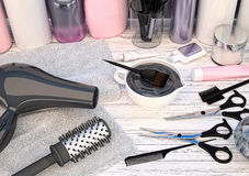Hair cutting shears, combs, hair dye and professional cosmetics. Hair cutting shears, combs, hair dye and professional cosmetics for hair located on a wooden Stock Image