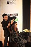 Hair cutting skills training. Trainer show the technique to cut hair with salon while training in Solo, Central Java, Indonesia. The training was followed by a Stock Photography