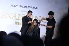 Hair cutting skills training. Trainer show the technique to cut hair with salon while training in Solo, Central Java, Indonesia. The training was followed by a Royalty Free Stock Images