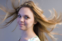 Hair day. Woman in a wind Stock Photography