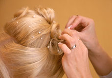 Hair dresser. Blond woman in beauty salon Stock Photos
