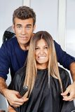 Hair Dresser And Client Making Faces Royalty Free Stock Images