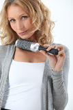 Hair-dresser holding brush Stock Photo