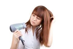 Hair dressing. The beautiful girl dries hair the hair dryer Stock Photos