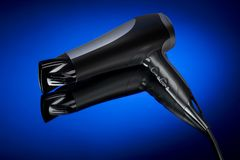 Hair drier. Laying on a background Royalty Free Stock Image