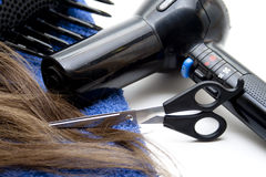 Hair drier with wig and scissors Stock Photos