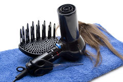 Hair drier with wig and scissors Royalty Free Stock Photos