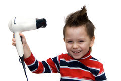 Hair dryer. Little boy with hair dryer on white background Royalty Free Stock Image