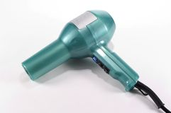 Hair Dryer. Teal colored hand held blow dryer for drying hair Royalty Free Stock Images