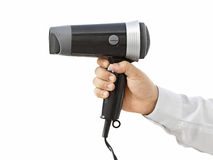 Hair dryer. Business man holding hair dryer stock images