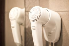 Hair dryer. In the hotel stock photography