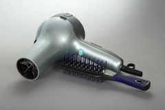 Hair dryer and hairbrush Stock Photo