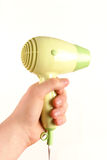 Hair dryer in hand Stock Photos