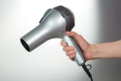 The hair dryer in a hand Royalty Free Stock Photo