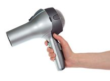 The hair dryer in a hand Stock Photography
