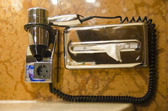 Hair dryer. Photo of a hotel hair dryer and napkins holder Royalty Free Stock Photo
